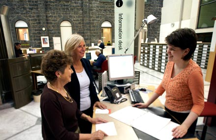 Staff providing information in the Genealogy Centre
