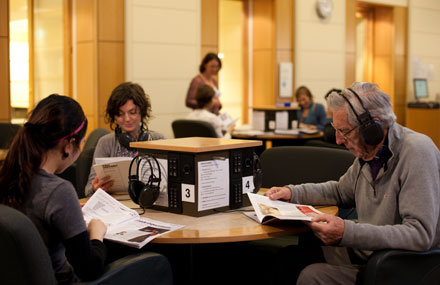 Group of people using listening post in Arts room © Andrew Lloyd