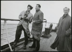 Three men standing on deck of the ship Liguria
