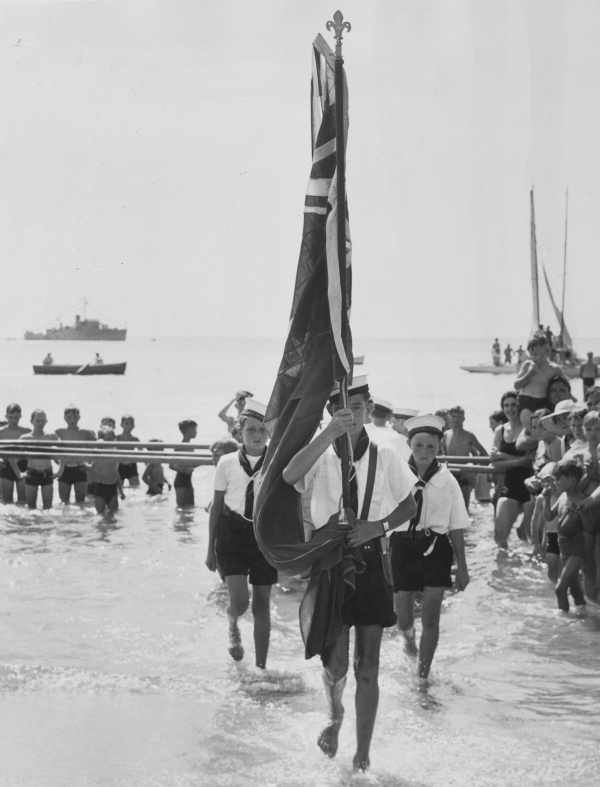 Sea Scouts carry the Australian flag at the Australia Day ceremony at Frankston(ca.1953)