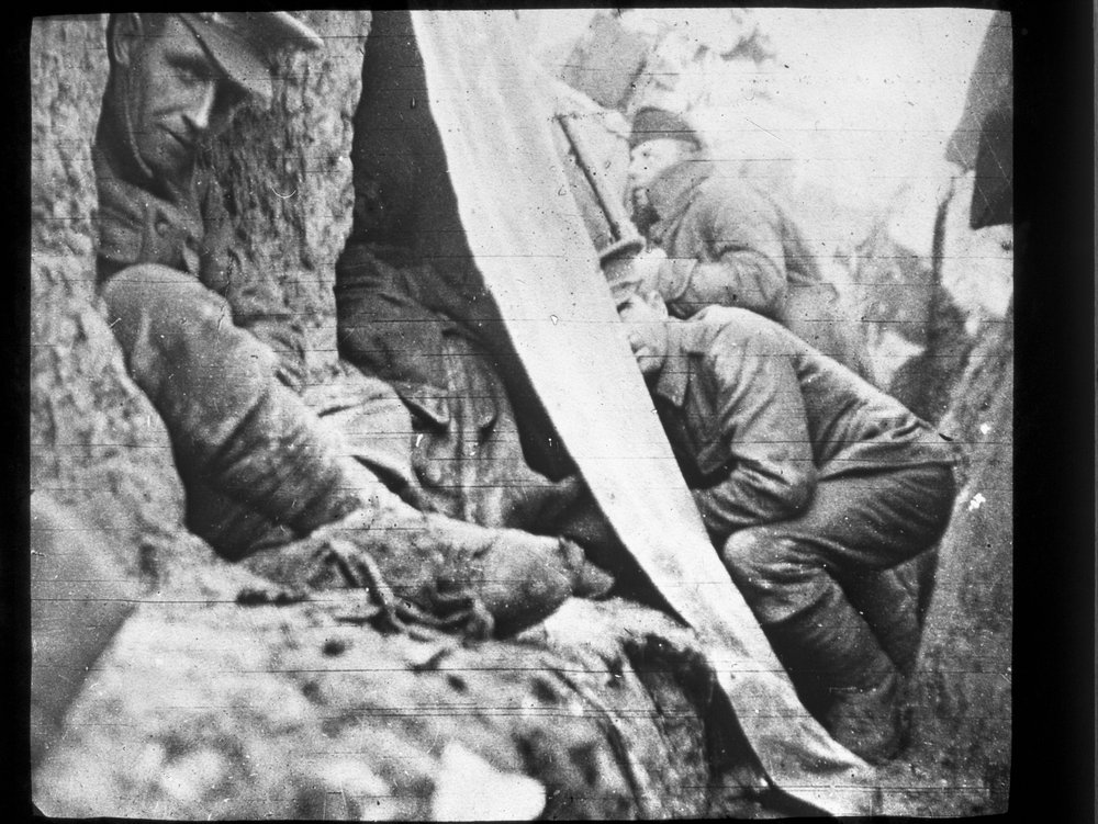 Soldiers taking cover in trench, T. P. Bennett, 1915