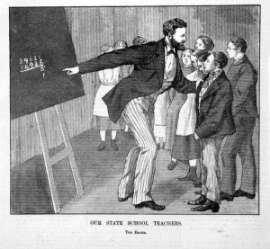 Engraving showing Shows teacher holding a child by the lapel of his coat and pointing to a sum on the blackboard behind him.