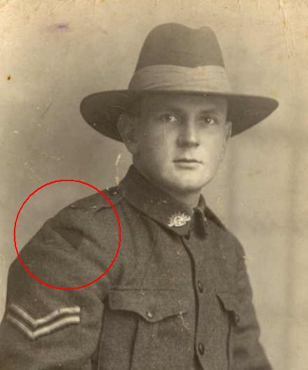 Portrait photograph of unidentified Australian soldier taken during World War I, with colour patch on sleeve of his uniform circled in red.