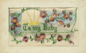 Verso of embroidered postcard with message from Corporal Tom O'Halloran to his daughter.
