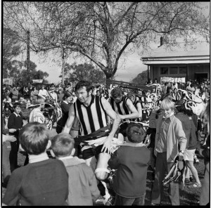 A player bursts through a banner at Benalla.