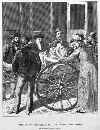 Wood engraving showing an injured Ned Kelly, lying on a cart beside the train and a tearful Miss Lloyd leaning over him, several men are standing around the cart and are obviously sympathic towards the outlaw and his cousin.