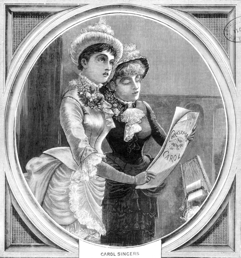 A. 1883 wood engraving showing two women singing Christmas carols.