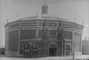 Shows black and white photograph of Cyclorama located in East Melbourne, of the Battle of Waterloo.
