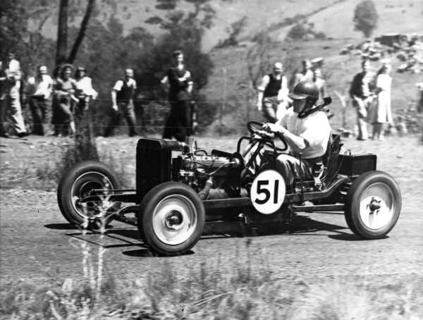 Shows Arthur Wylie setting a new record of 29.47 seconds in the 1940 Rob Roy Hill Climb.