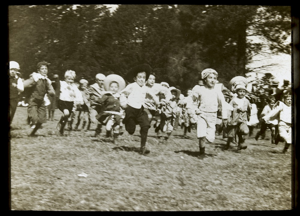 Children's running black and white photograph