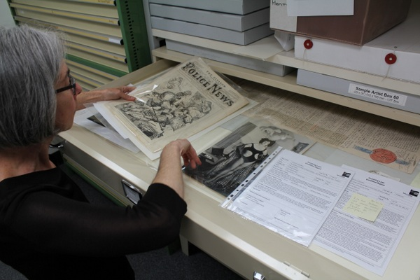 Jane with 'Bohemian Melbourne' material in the Conservation department