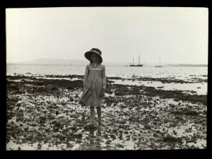 Girl standing on rocks 1910