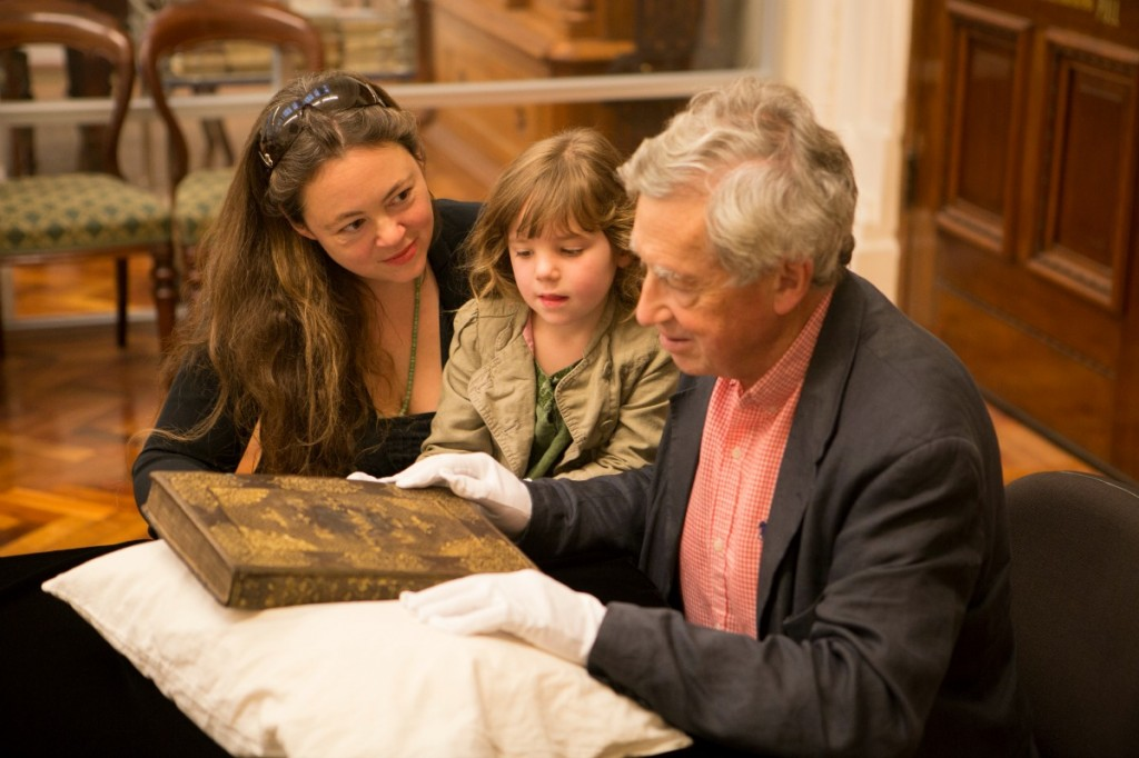 Dr Emmerson's brother, David Emmerson, niece Chloe, and great-niece Genevieve view the collection