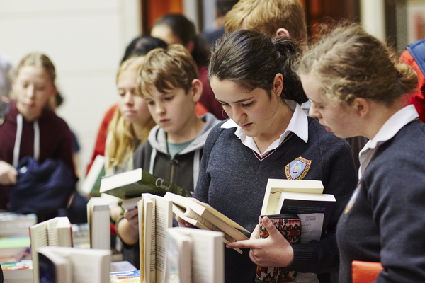 Children reading books at the Reading Matters conference