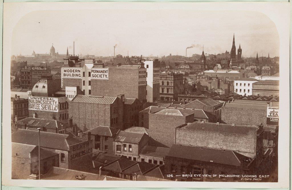 Black and white photograph of a bird's-Eye View of Melbourne looking east across rooftops