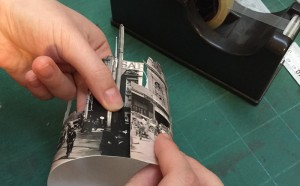 Photo of someone making a cylinder from paper