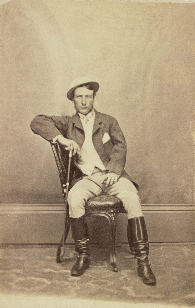 Photograph of Marcus Clarke sitting on a chair