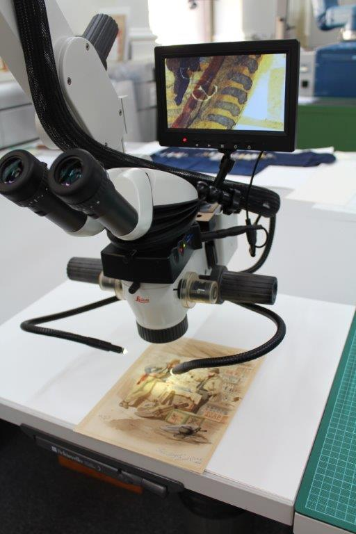 Image of a microscope in the Library's conservation department viewing an ST Gill image