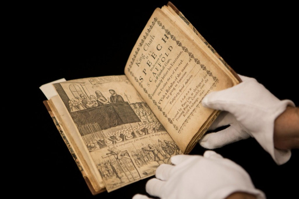 Image of book being held by white gloves