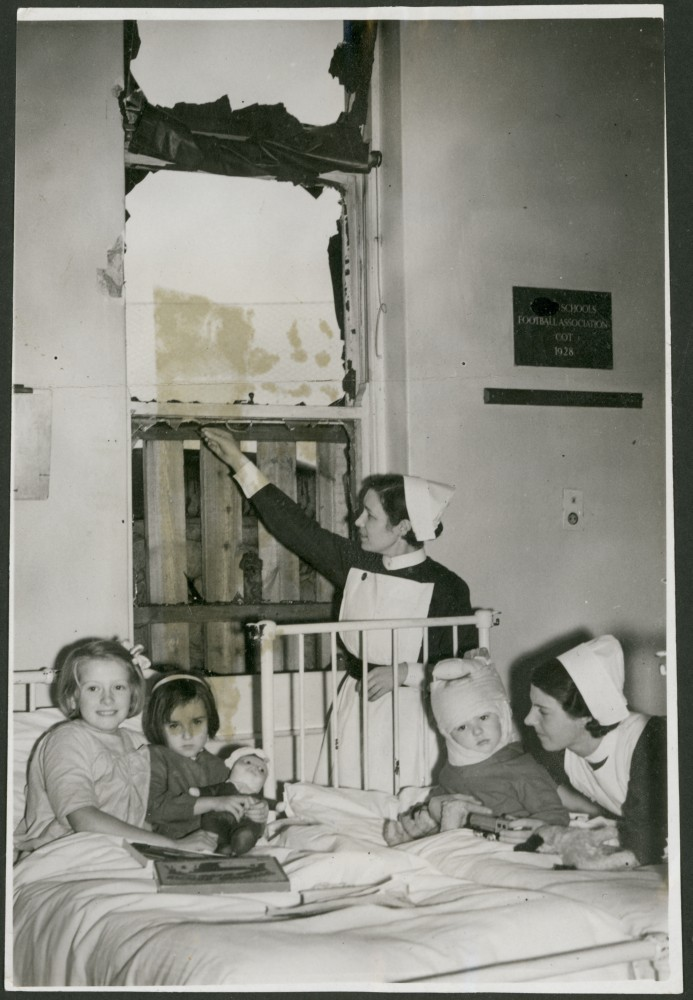 Nurses decorating damaged children's ward at Christmas time.