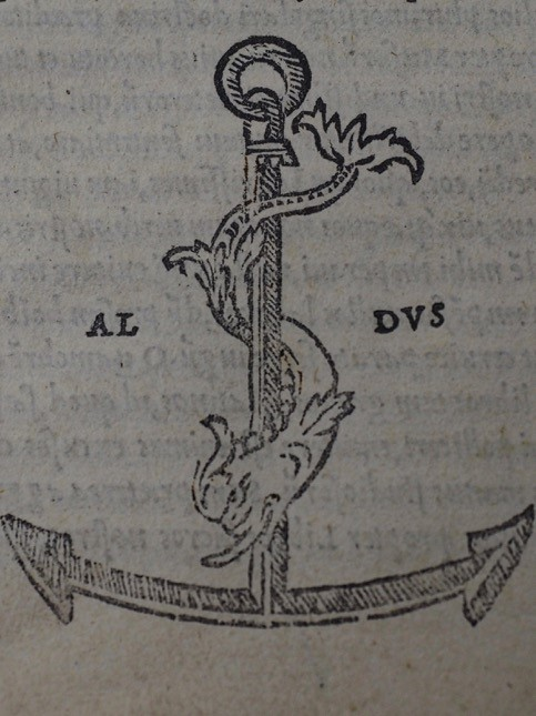 Printer's device of the anchor and dolphin.