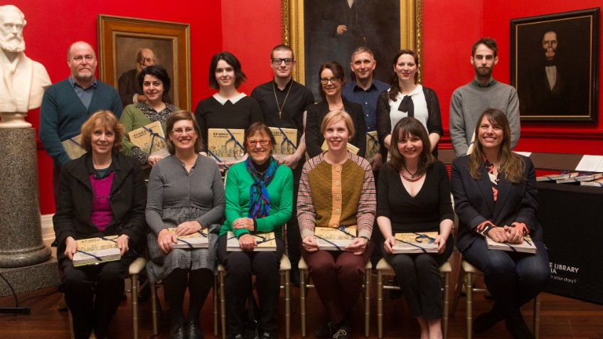 Portrait of a group of people in the State Library's Red Rotunda