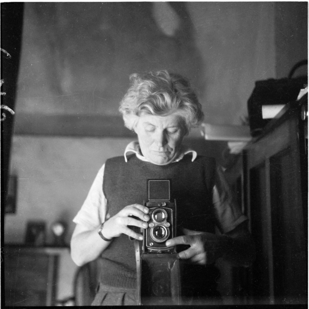 Photograph of Edna Walling taking a photograph of herself