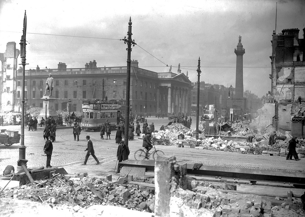 Image of a street scene in Dublin with people, a tram and rubble