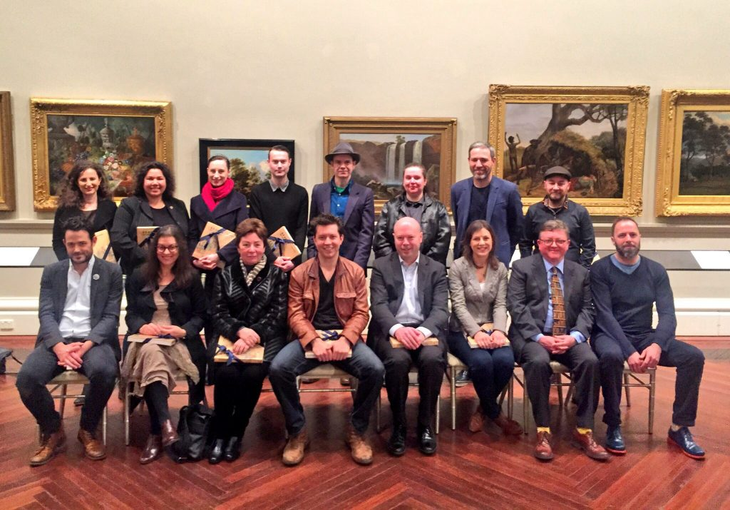 Image of the 2016 Fellows posing for a photograph in State Library Victoria's Cowen Gallery
