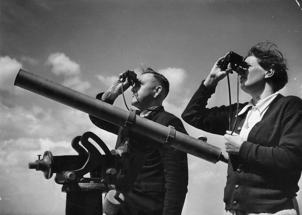 Image of a man and a woman with bionoculars