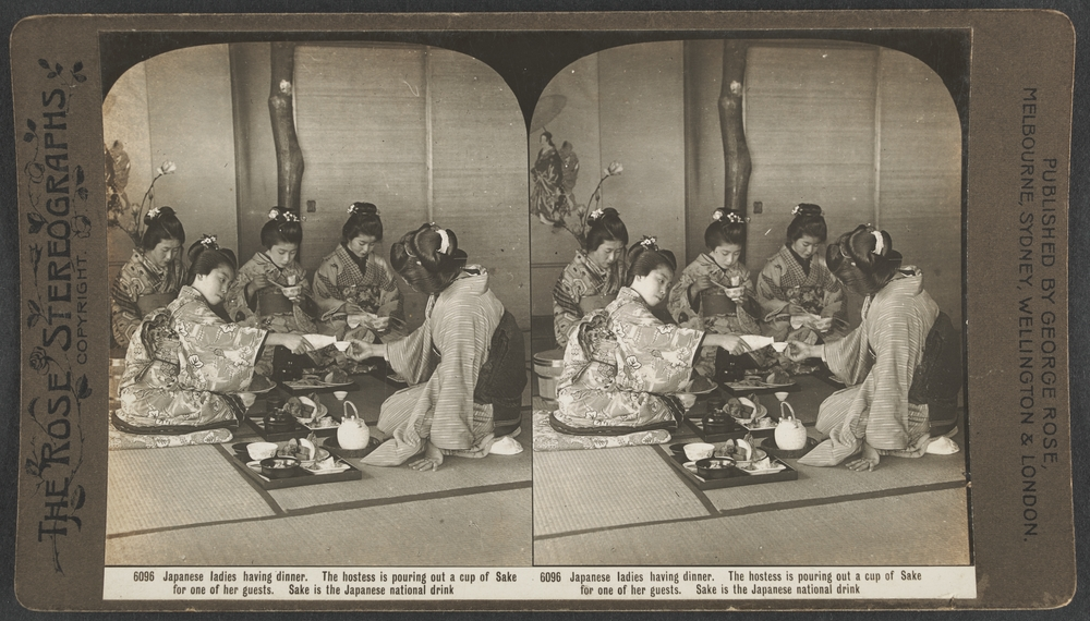 An old photo showing Japanese women having dinner.