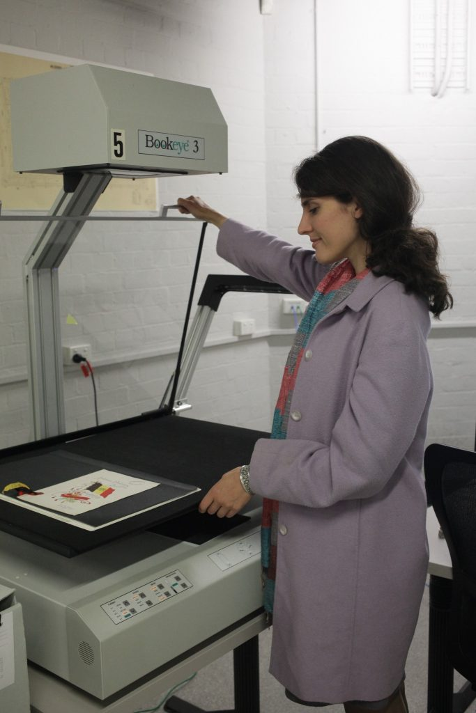 Image of Melanie scanning an object in the Bookeye 5 scanner