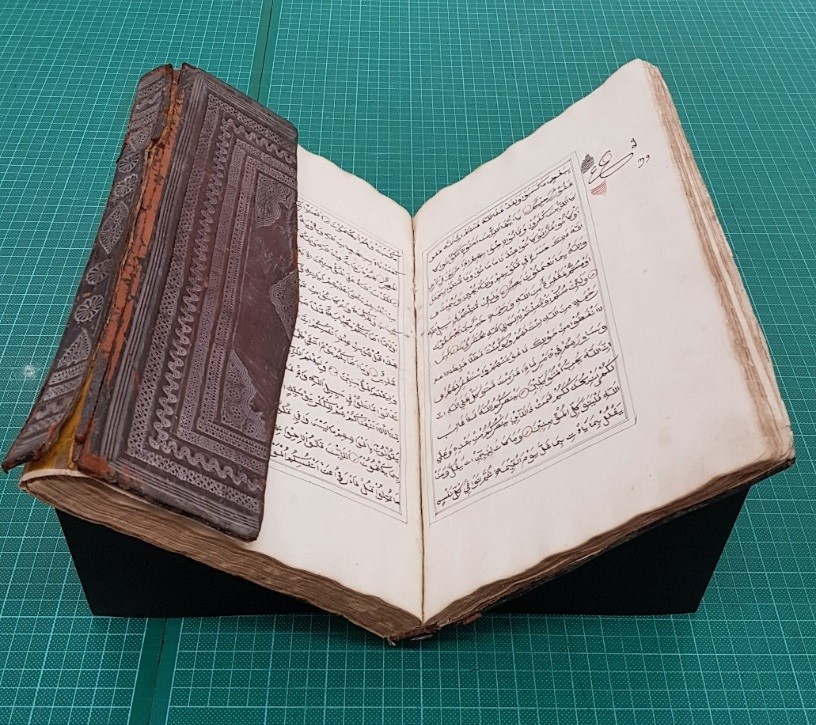 Qur'an from the Michael Abbott Collection being prepared for display in World of the Book.