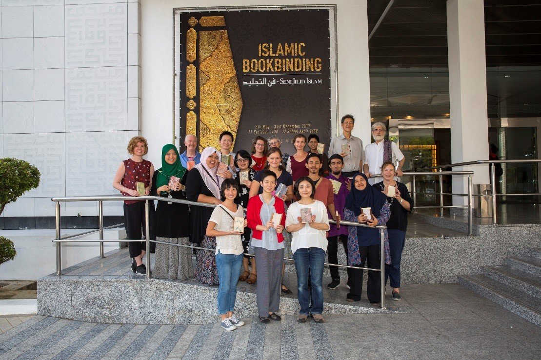A group of people outside the the Islamic Arts Museum of Malaysia