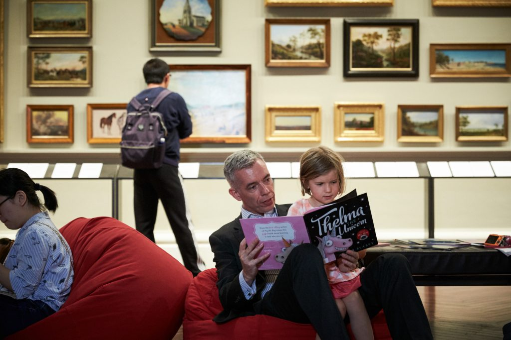 A man and a child read a children's book.