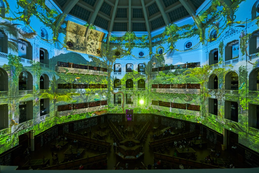 The La Trobe Reading Room covered by jungle projections.