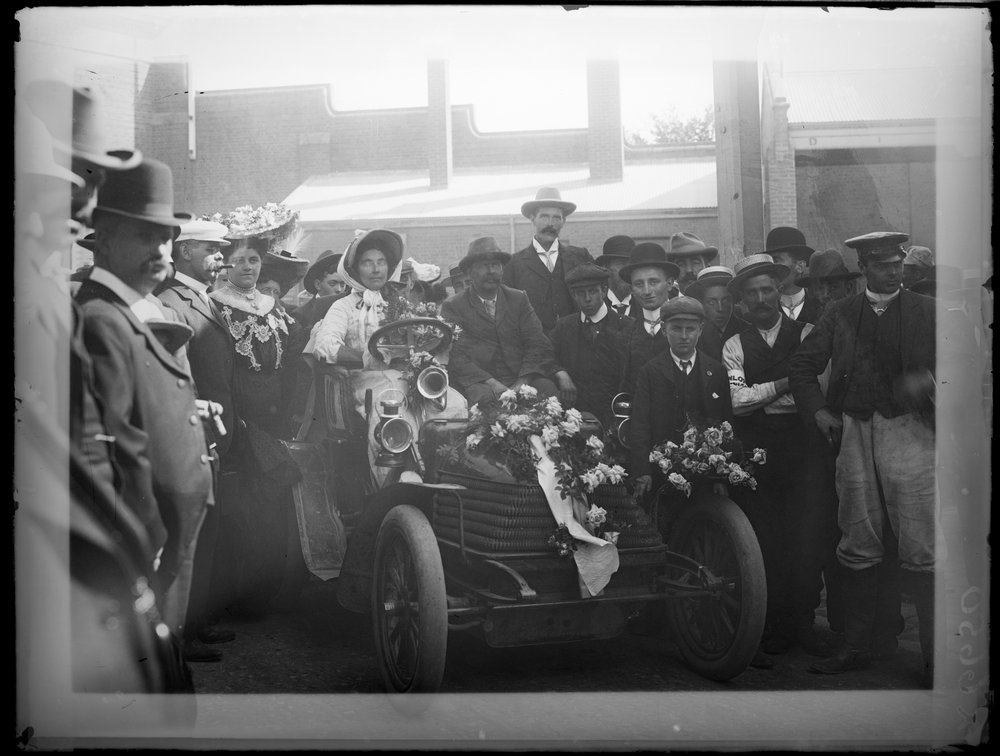 Mrs. Thomson's Wolseley bedecked with flowers at the finishing line of the Reliability Trial