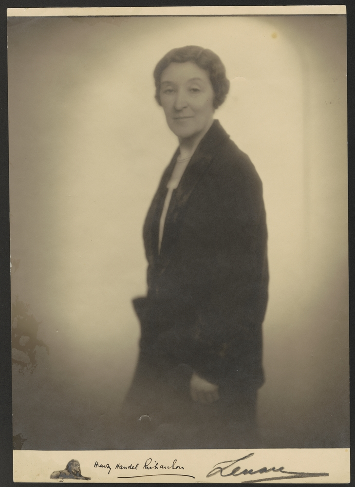 A sepia-toned portrait of a woman.