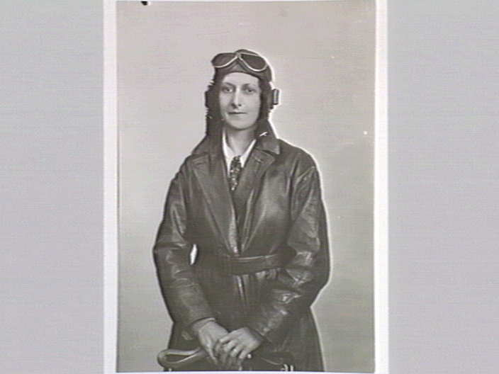 A woman in pilot garb.