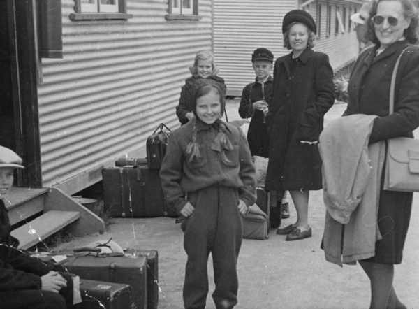 smiling girl and woman with suitcases