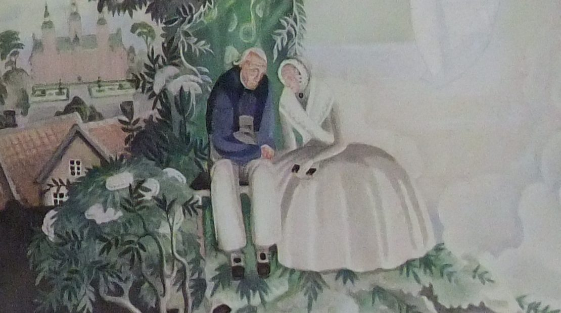woman and man sitting with tree