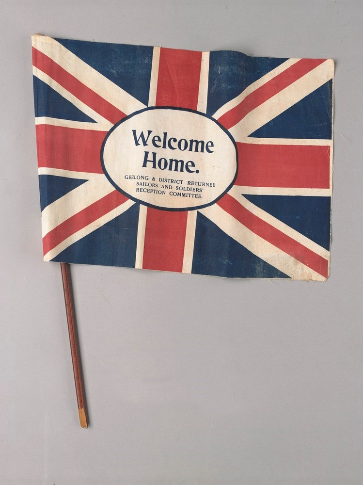 flag that reads 'Welcome Home'