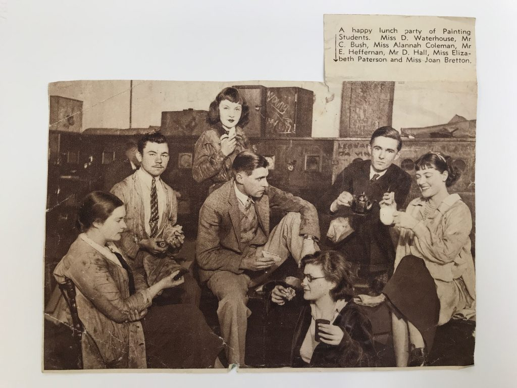 A group of seated students drinking tea