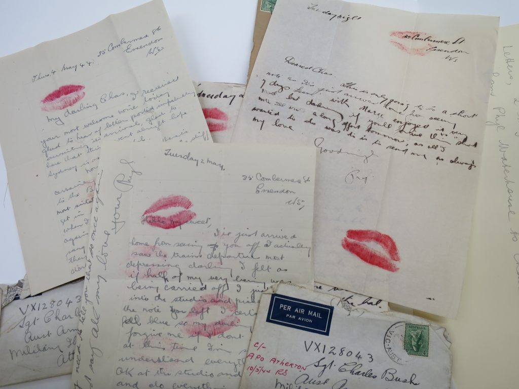 Grouping of letters and envelopes with lipstick kisses