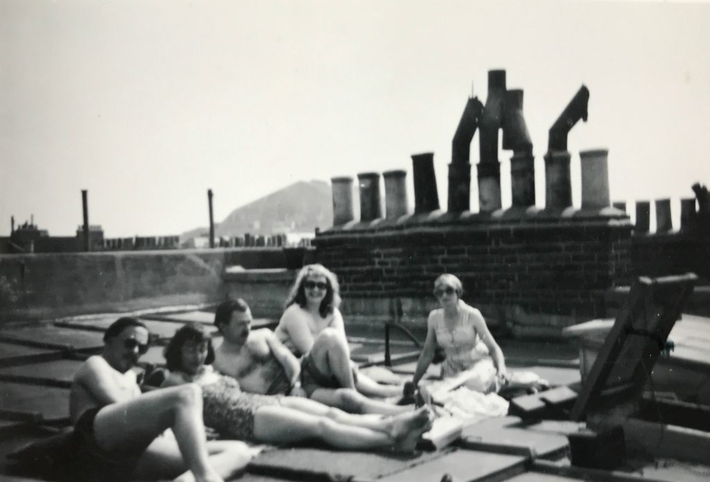 Group of reclining men and women on a rooftop
