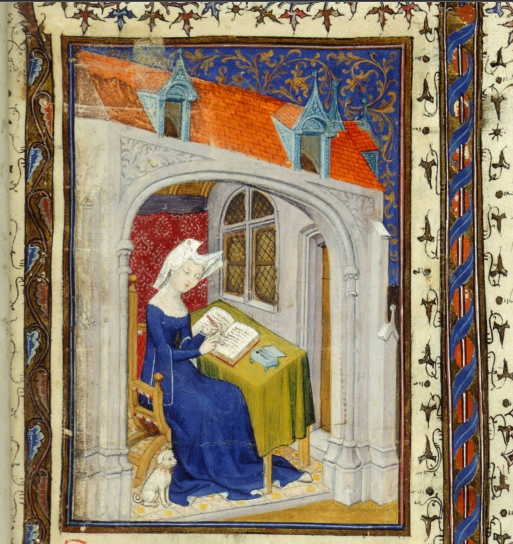 Christine de Pizan sits at her writing desk, with a small white dog at her feet. The image is from a medieval manuscript of Christine's works.