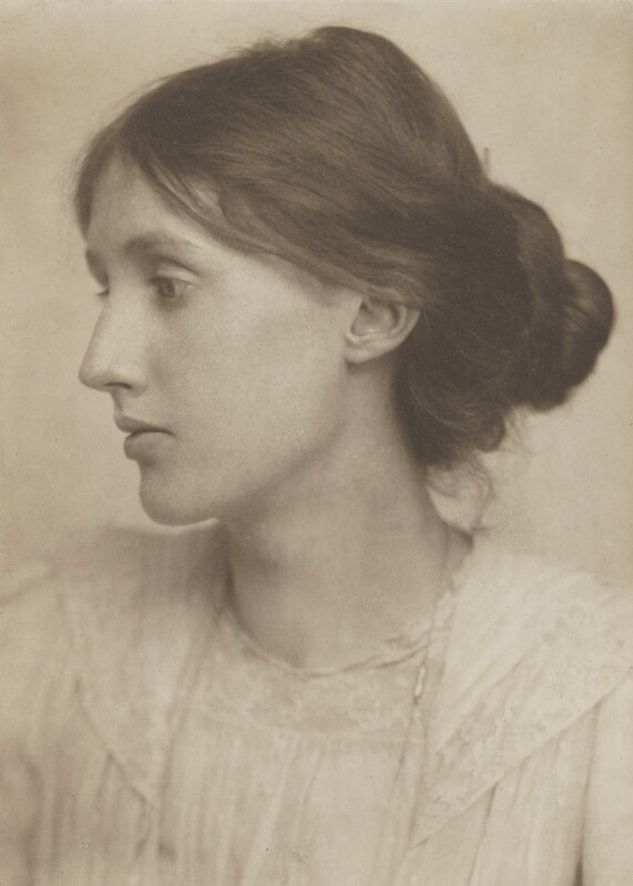 A portrait of Virginia Woolf aged 20, facing to her right, with her hair gathered in a loose bun.