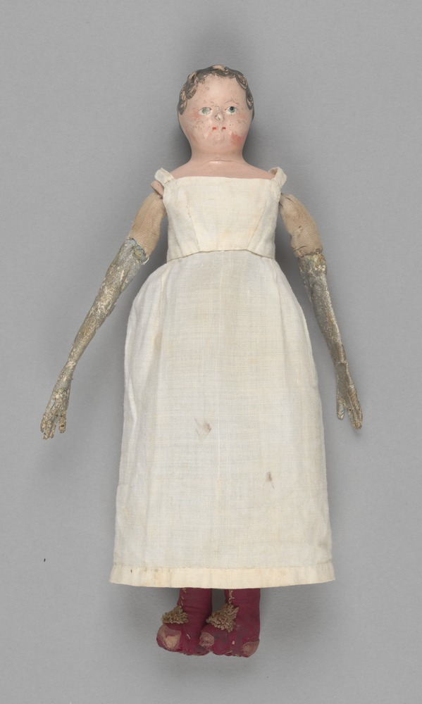 Elizabeth Batman's doll minus bonnet, wearing pinafore