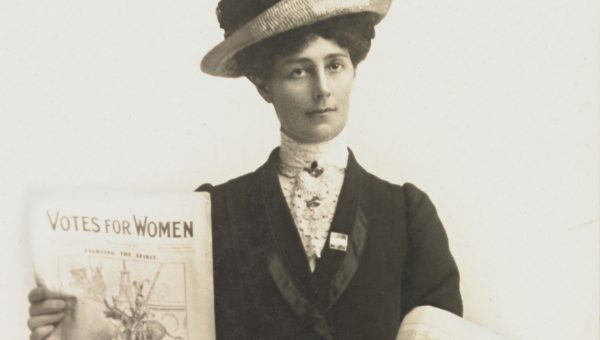 portrait of suffragette selling papers