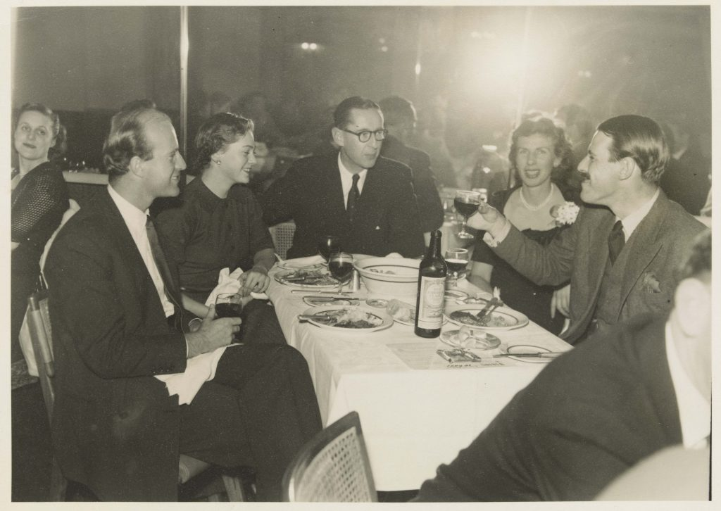 Group of people seated at table in restaurant